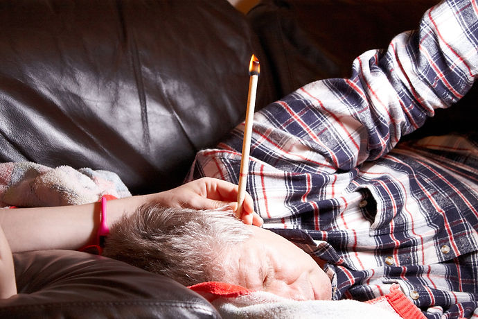 A Mature Male having hopi ear candle treatment