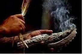 Smudging to remove negative energy.