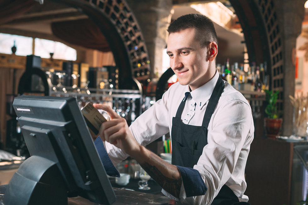 small business, people and service concept - happy man or waiter in apron at counter with