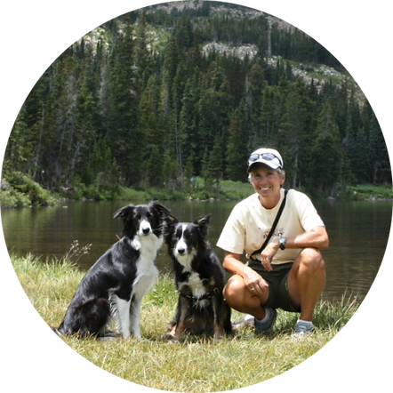 PSFD Founder Liz Blasio and her dogs hike off-leash by a mountain lake.