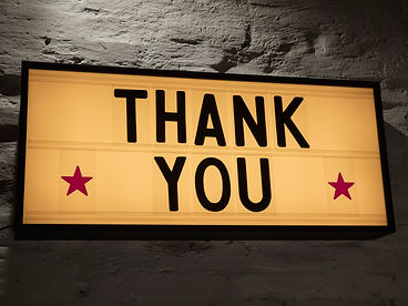 close-up-of-thank-you-signboard-against-