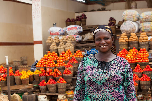 African woman selling fresh fruits and v