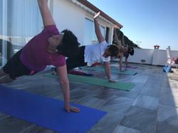 Yoga With VickiB Morning yoga retreat class on terrace overlooking Vasisthasana side plank pose