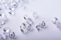 Diamond with tweezers and magnifier.Gemstone Beauty_.jpg