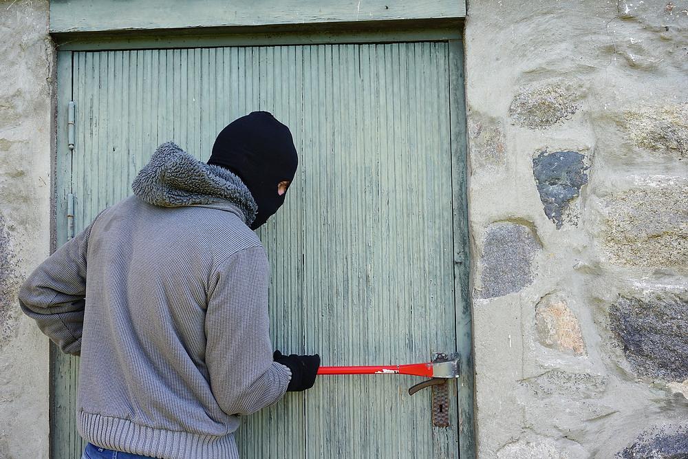 Burglar attempting break in