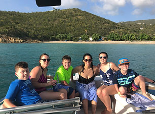 Family on the bow of Empire March overlooking St Thomas