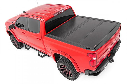 GM LOW PROFILE HARD TRI-FOLD TONNEAU COVER (19-20 1500)