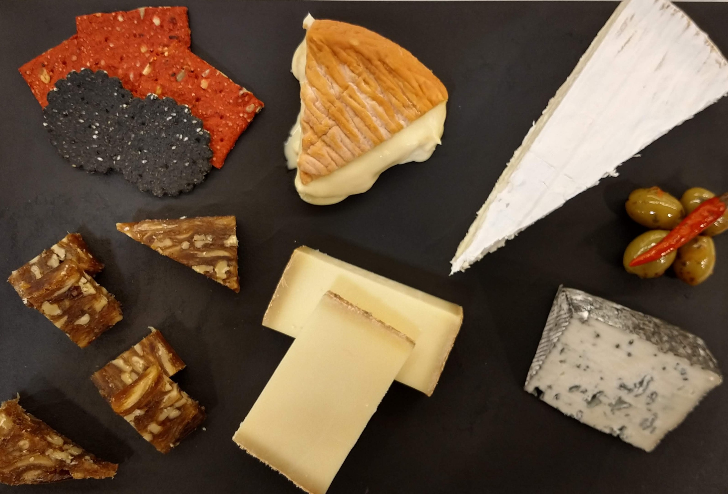 A vibrant cheese board designed by the Cheesy1.