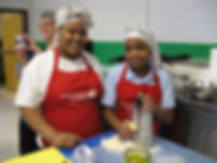 FoodRight Youth Chef Academy students in aprons and chef hats