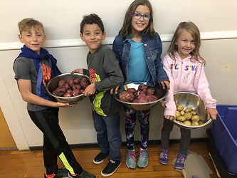 FoodRight Youth Chef Acadey students with home grown potatoes