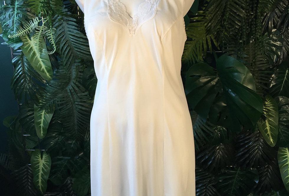 White slip with scalloped neckline