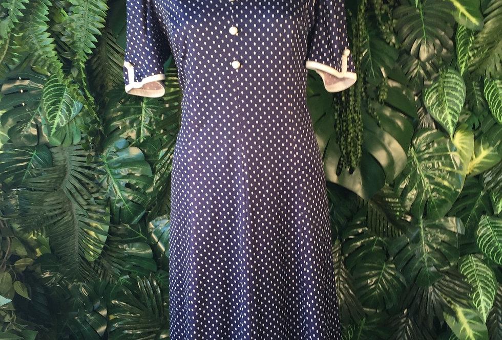 Navy polka dot dress with white trim (size 14)