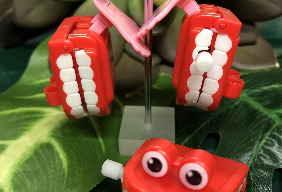 Windup teeth 🦷 earring