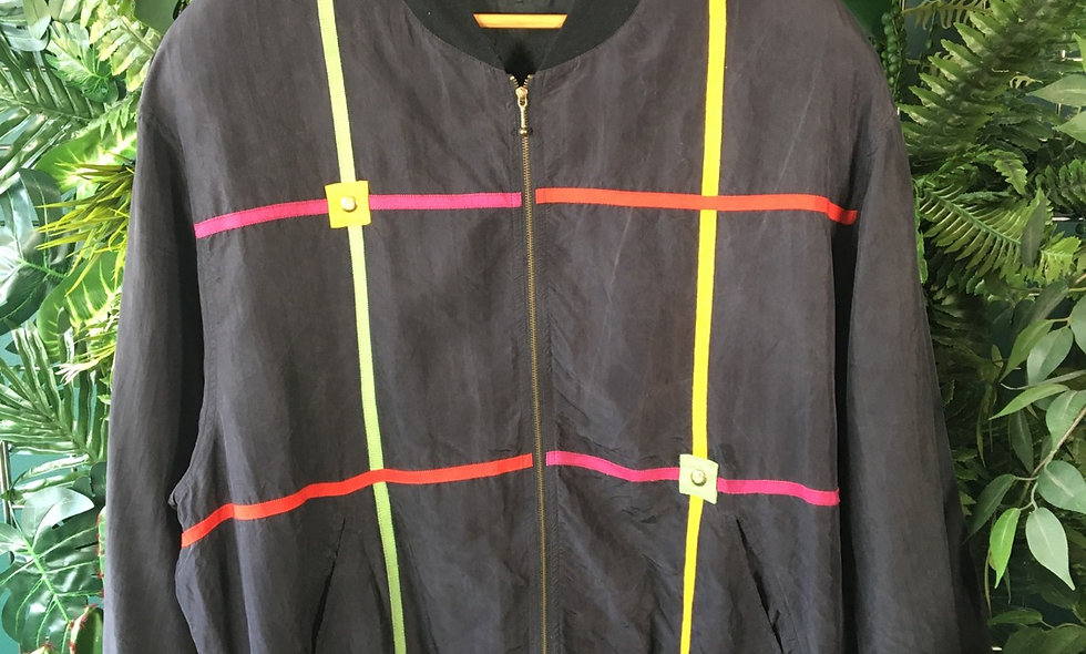 Grid pattern jacket with button detail.