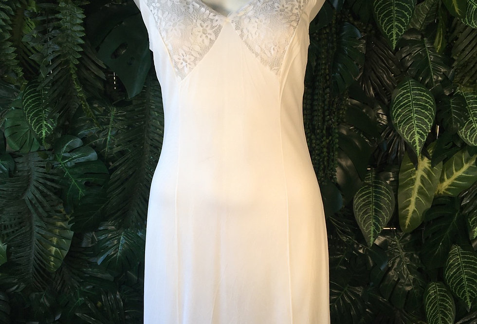 White slip with lace bust detail