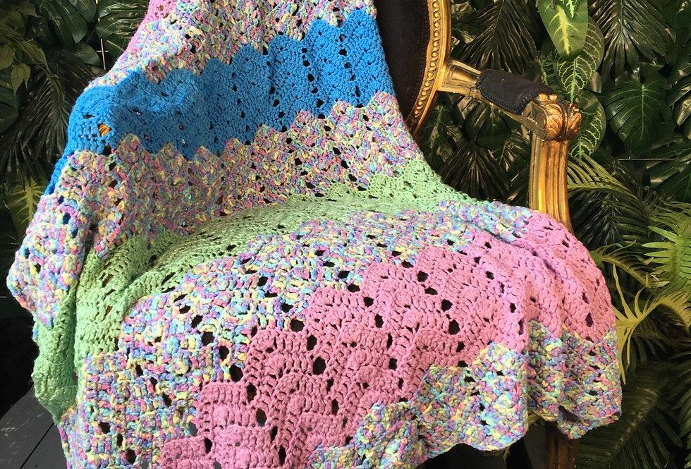 Hand crocheted multicolour blanket