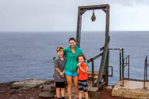 The family at the Southernmost point... I took about 10 pictures and the boys eyes are closed in all of them.  You also probably can't tell but its raining!