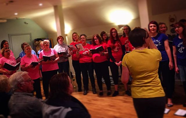 Great shot in Action! #headsup #colours #rainbow #choir #sing #laugh #love #yellow #red #purple #pin