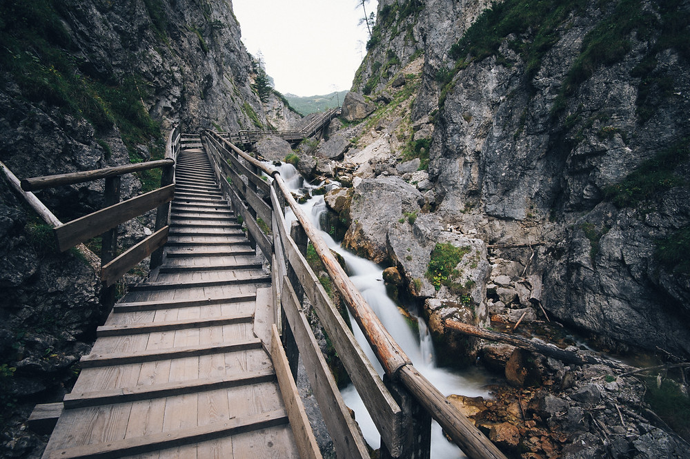 wooden-stairs-through-mountains-require-motivation