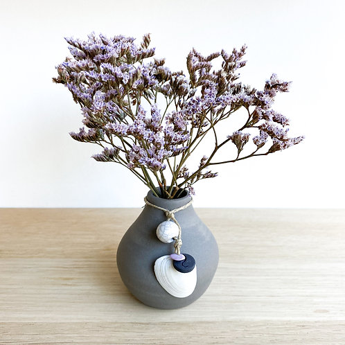 Small grey vase with pink stone necklace