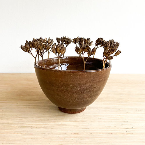 Small bowl with dried flowers on rim