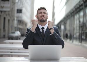 man-in-black-suit-sitting-on-chair-besid