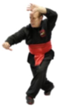 Man in Kung Fu pose in red sash