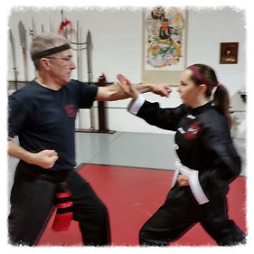 Man and woman practicing Kung Fu partner work