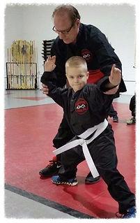 man teaching youth kung fu