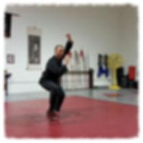 man in kung fu pose