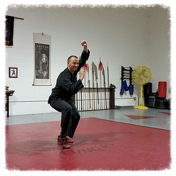 man in kung fu pose