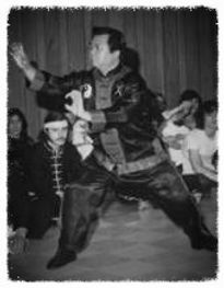 Black and White Image of Master Wong Ting Fong showing spar action with tiger claws kung fu