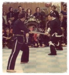 Men training in Kung Fu contact weapons set