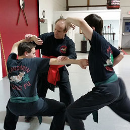 Man instrucing students in kung fu training