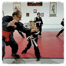 man teaching youth kung fu class
