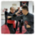 People practicing Kung Fu in the dojo