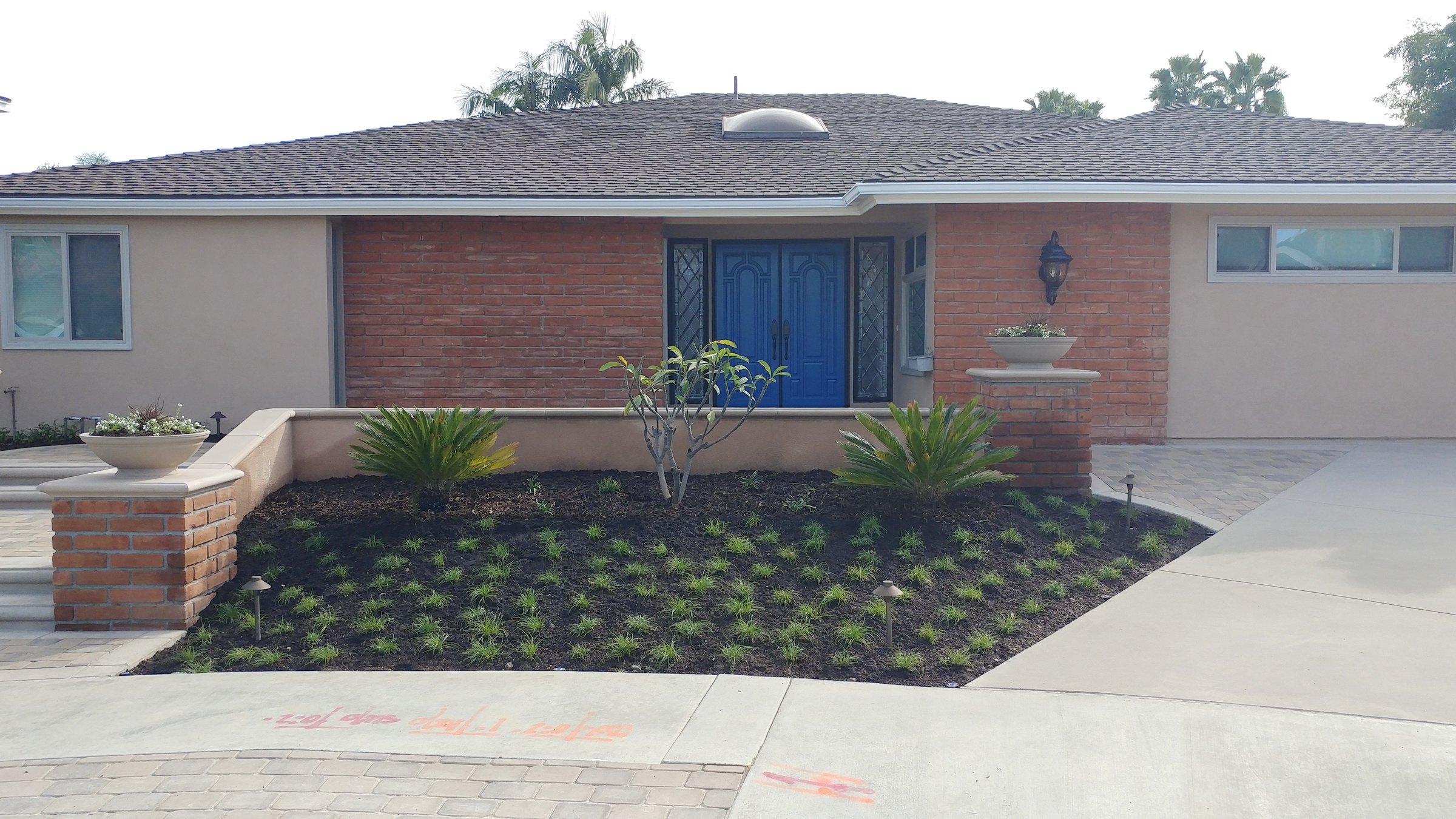 Refreshed entry with new landscape and hardscape.