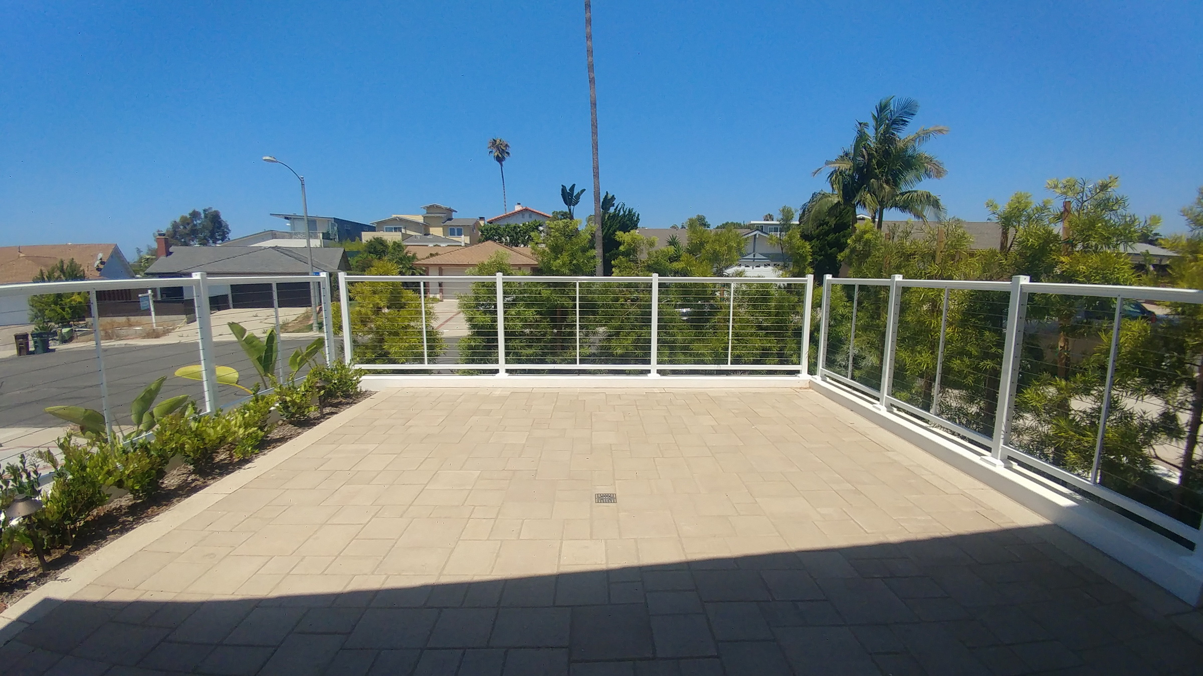 Cable railing and patio paving