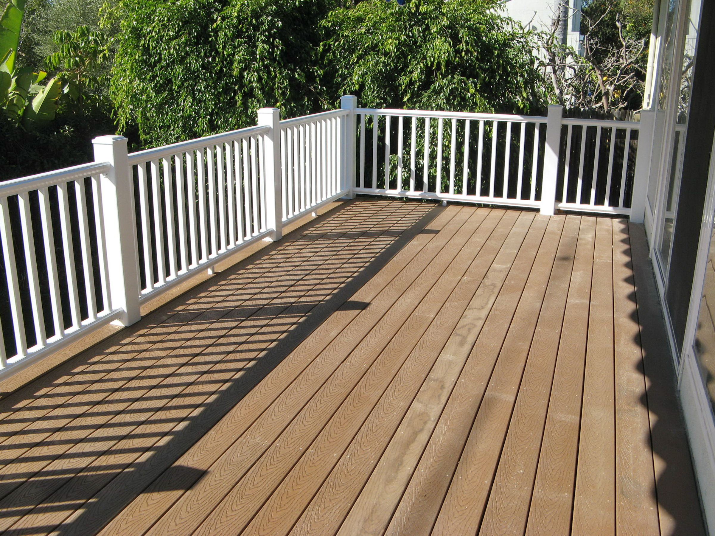 Vinyl deck railing with TimberTech planking