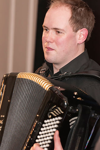 Accordionist Paul Chamberlain playing wirth the ceilidh band