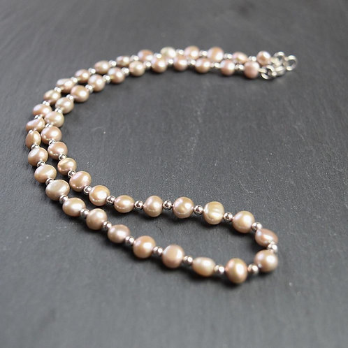 Pearl and silver necklet on a silver clasp.