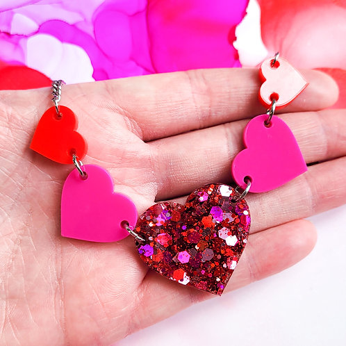 Handmade pink and red resin heart statement necklace