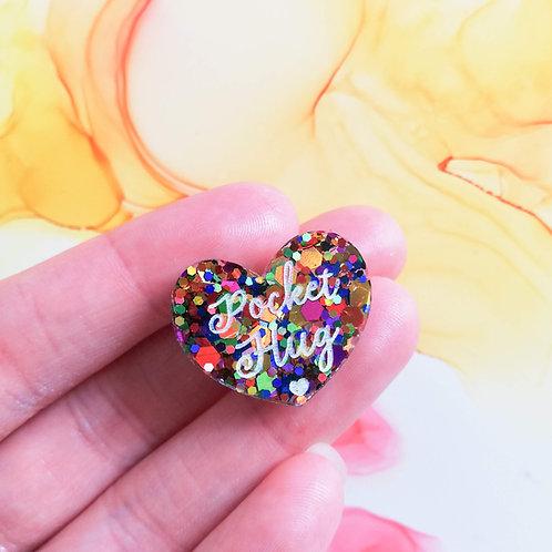 Handmade small rainbow glitter resin pocket hug pins on a card, isolation gift