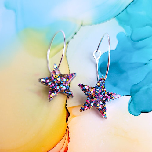 Handmade glitter resin star charms on silver plated hoop earrings
