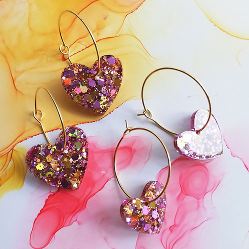 Handmade pink and gold glitter heart resin earrings on gold plated hoops
