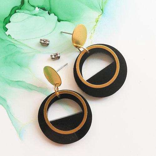 Handmade black circle resin earrings with brass charm