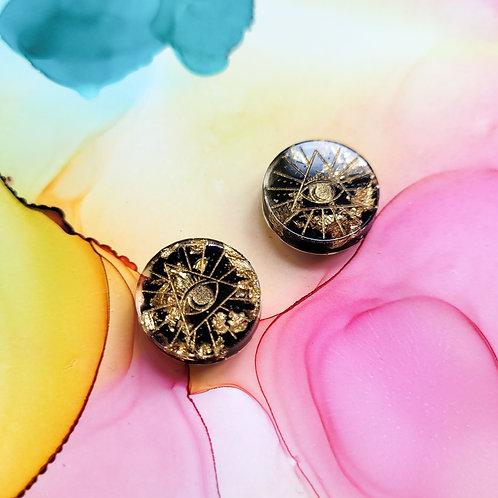 Handmade all seeing eye black and gold resin stud earrings