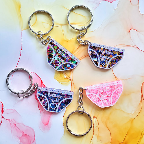 Handmade glitter positive pants resin keychain