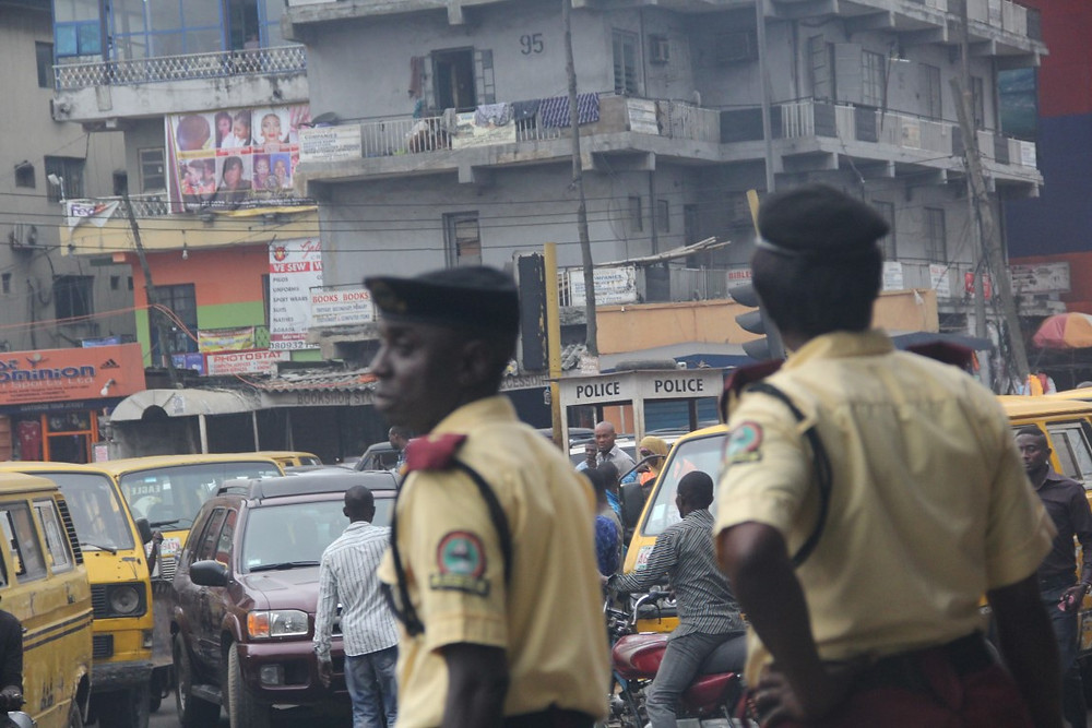 (Typical roundabout of Lagos with officers)