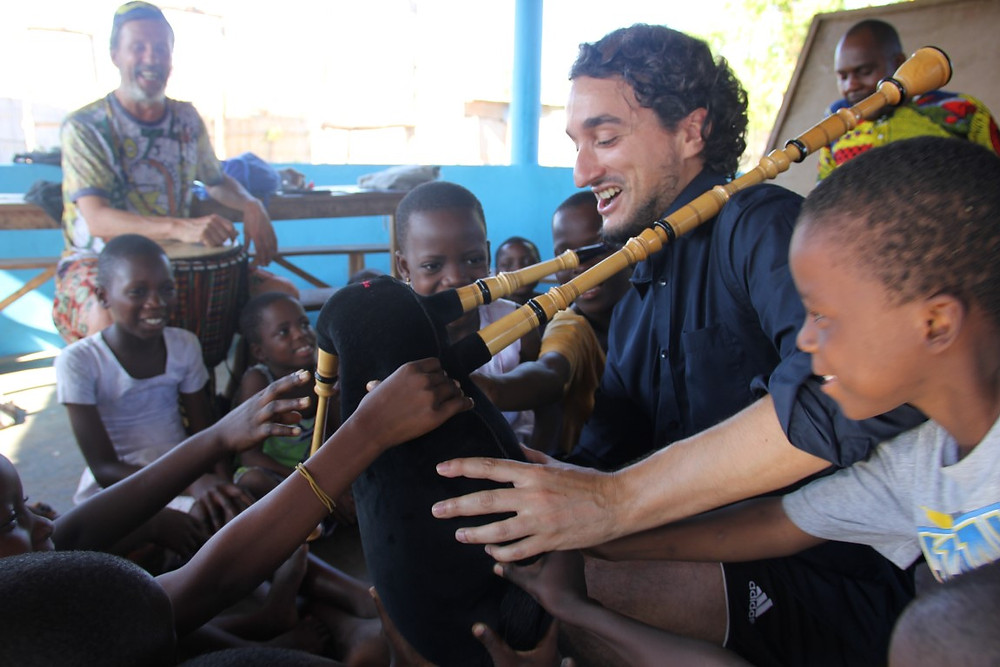 Aibeo playing bagpipes at the Grand-Popo Orphanage, photo by Liisa Manninen